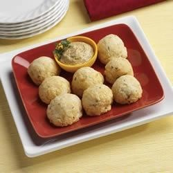 Sauerkraut and Sausage Balls Recipe - Bite-size balls of sausage and sauerkraut are wrapped in a Swiss cheese dough and baked until golden brown.