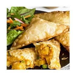 Vegetable Samosas Recipe - Peas, carrots and potatoes in a spicy red curry sauce are folded into wonton wrappers and fried until golden brown in this classic appetizer or side dish.