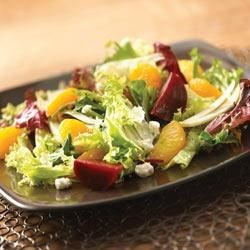 Beet, Fennel and Mandarin Orange Salad Recipe - Roasted beets and sweet oranges are dressed with a sherry-shallot vinaigrette in this flavorful salad.