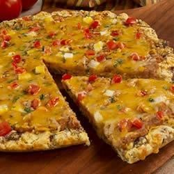 Mexican Sausage Pizza Recipe - A crumbled sausage and grated Cheddar cheese crust is topped with onions, tomatoes, fresh cilantro and more cheese in this Mexican-inspired pizza.