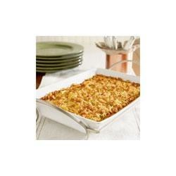 Squash Casserole Recipe - This creamy crowd-pleasing side dish features summer squash, carrot, stuffing mix and cheese baked in a creamy sauce. Crispy on top and creamy in the center, this favorite side dish is a winner on any menu.