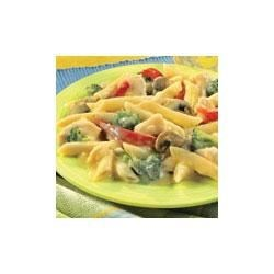 Chunky Chicken Primavera Recipe - Chicken and vegetables are tossed with pasta and a creamy sauce for this simple dinner.