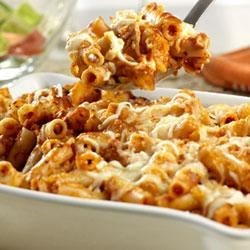 Baked Ziti Recipe - Short tube-shaped pasta tossed with seasoned tomato sauce, mozzarella and Parmesan cheeses is baked in a casserole until bubbling.