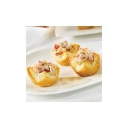 Apple Port Pastry Cups Recipe - Pepperidge Farm(R) Puff Pastry Sheets make tender pastry cups that are filled with a delightful combination of chopped apples, lemon juice, brown sugar, cinnamon, port wine and mascarpone cheese, and baked until the filling is hot.