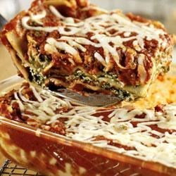 Extra-Easy Spinach Lasagna Recipe - Cheesy lasagna becomes more colorful and flavorful with the addition of spinach and Prego(R) Fresh Mushroom Italian Sauce.