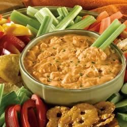 Frank's(R) Red Hot(R) Buffalo Chicken Dip Recipe - This robust and creamy appetizer features cream cheese, blue cheese salad dressing, cayenne pepper sauce, crumbled blue cheese and Swanson(R) Premium Chunk Chicken, heated together to make a dip that tastes like Buffalo chicken wings but without the mess!
