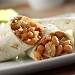 Campbell's(R) Chicken and Bean Burritos Recipe - These quick and tasty burritos feature a zesty combination of Campbell's(R) Condensed Bean with Bacon Soup, Pace(R) Thick and Chunky Salsa and Swanson(R) Premium Chunk Chicken, heated and served inside warmed flour tortillas.