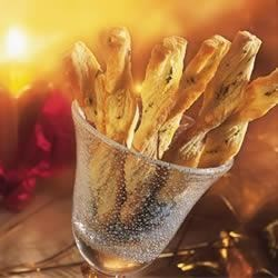 Parmesan Cheese Twists Recipe - Twisted Pepperidge Farm(R) Puff Pastry strips laced with Parmesan cheese, parsley and oregano are easy to make for dinner to accompany a steak and Caesar salad. Make ahead and freeze; remove directly from freezer to oven to bake.