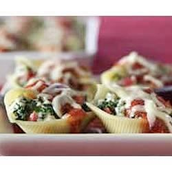 Stuffed Shells Recipe - Jumbo pasta shells filled with spinach, cheese and oregano are baked in pasta sauce for a quick and delicious weeknight meal.