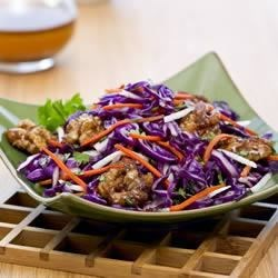 Asian Coleslaw with Candied Walnuts Recipe - This colorful coleslaw with shredded jicama is tossed with a citrus and ginger dressing then topped with candied walnuts.