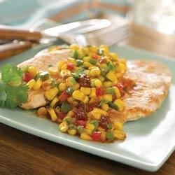Roasted Red Chili and Strawberry Turkey Cutlets Recipe - Quickly pan-fried turkey cutlets are served with a sweet and spicy sauce chunky with corn and fresh cilantro.