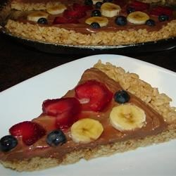 Yummy Fruit Pizza Recipe - It is a pizza made with a crisp rice crust, chocolate sauce, fruit and whip cream. It's great for camping and birthdays. I love it!