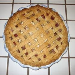 Evie's Rhubarb Pie with Oatmeal Crumble Recipe - Rhubarb is sweetened and topped with a crunchy oat topping in this delicious and easy to make pie. A dear family friend always grew rhubarb and made this pie with her bounty each year.  People are skeptical when they hear it is a rhubarb pie without strawberries but after only one taste, they understand the magic of this pie. Serve with vanilla ice cream for added sweetness!