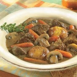 Herb-Simmered Beef Stew Recipe - Flavorful beef is braised slowly with a medley of vegetables in rich beef broth.