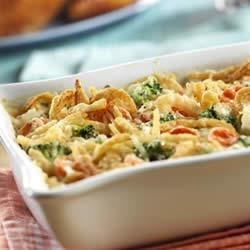 Campbell's(R) Swiss Vegetable Casserole Recipe - A colorful vegetable combination is mixed with Campbell's(R) Condensed Cream of Mushroom Soup, Swiss cheese and sour cream, then topped with French fried onions and more Swiss cheese, and baked until golden and bubbly.