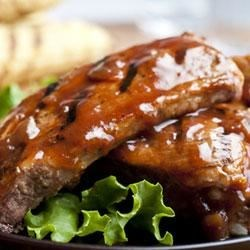 Campbell's(R) Honey Barbecued Ribs Recipe - Tender, parboiled ribs are glazed on the grill with a flavorful sweet-and-spicy sauce that features Campbell's(R) Condensed French Onion Soup, ketchup, onion, honey and garlic powder.