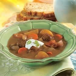 Slow-Cooker Beef and Vegetable Soup Recipe - For this hearty stew, beef, carrots, and potatoes simmer all day with a flavorful beef broth mixed with tomato paste and coffee.