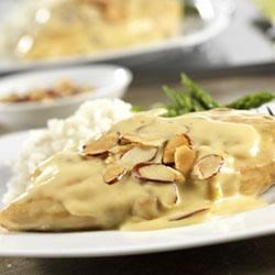 Creamy Almond Chicken Recipe - Campbell's(R) Condensed Cream of Chicken Soup, heavy cream, orange marmalade, red pepper flakes, Dijon-style mustard and almonds perfectly season a creamy and delicious sauce for pan-fried chicken.