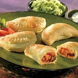 Spicy Black Bean Empanadas Recipe - Spiced black beans, ground pork and vegetables are wrapped in flaky puff pastry before baking to a golden brown.