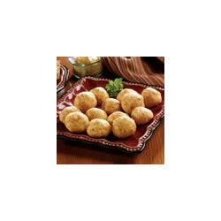 Cheesy Sausage Tidbits Recipe - Snack on these tasty sausage links wrapped in a savory Cheddar cheese biscuit.