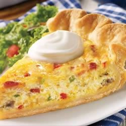Daisy Brand Quiche Recipe - This classic quiche is a rich blend of eggs, bacon, Swiss and Cheddar cheese, veggies and sour cream. Serve it warm with a dollop of Daisy.