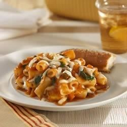 Veggie Lover's Baked Ziti Recipe - Baked pasta dish featuring summer squash, spinach and mozzarella cheese in a tomato-Alfredo sauce.