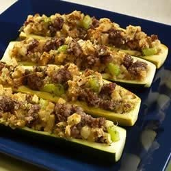 Stuffed Baked Squash Recipe - Summer squash are stuffed with a savory mixture of sausage and stuffing then baked until the squash is tender and the stuffing is nicely browned.