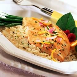 Citrus Chicken and Rice Recipe - A delicious combination of orange juice and Swanson(R) Chicken Broth simmer to make a delicate chicken and rice skillet meal.