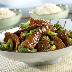 Beef and Broccoli Recipe - Steak strips are stir-fried with broccoli and simmered in a tangy tomato sauce. Served over rice, this tasty dish is sure to please your dinnertime crowd.