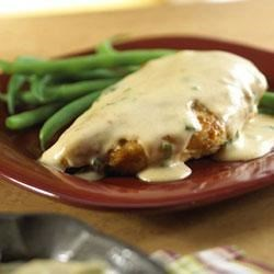 Paprika Chicken with Sour Cream Gravy Recipe - Browned chicken breasts are seasoned and sauteed, then cloaked in a smooth sauce made with sour cream, green onion and Campbell's(R) Condensed Cream of Chicken Soup.