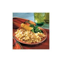 Chicken and Noodles Recipe - Country-style home cooking doesn't get any better than this satisfying dish of cooked chicken, cheese and hot pasta in a creamy sauce.