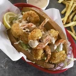 Shrimp Po' Boys Recipe - Crispy fried shrimp sandwiches are served piping hot with a spicy and tangy remoulade sauce.