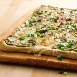 Potato Pesto Pizza Recipe - Small red potatoes, mozzarella, garlic and pesto create a pizza that is packed with flavor! Starting with Pillsbury(R) refrigerated artisan pizza crust with whole grain, it's on the table in less than 30 minutes.