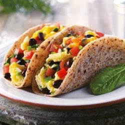 Blue Corn Breakfast Taco Recipe - Take the breakfast taco to a whole new level with this blue corn creation. Spinach, garlic and olive oil complement the egg perfectly, while the pico de gallo adds some kick.