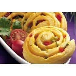 Mexican Confetti Pinwheels Recipe - Nacho cheese dip provides a kick in a tender crescent appetizer.