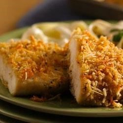 Crispy Garlic-Parmesan Chicken Recipe - Chicken gets dipped in a buttery-basil blend and coated with cheese-spiked Italian flavored panko bread crumbs, then it's baked until crispy and golden brown.