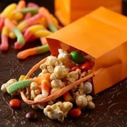 Caramel Corn Treat Bags Recipe - Caramel corn gets you started in creating Halloween treat bags with candies, nuts, raisins--choose your favorites!