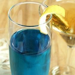 Lady Joy Recipe - Lemon rum and blue curacao at the bottom of a flute of sparkling wine.