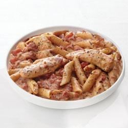 Creamy Parmesan and Sun-Dried Tomato Chicken Penne Recipe - Dinner can be ready in less than 30 minutes with this great-tasting chicken and pasta recipe.
