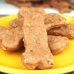 Doggie Biscuits II Recipe - Make something special for your canine friends. These wholesome biscuits are great for big dogs with wheat, cornmeal and rye flour. They are baked overnight to make them extra crunchy.