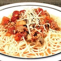 Marica's Spaghetti Meat Sauce Recipe - Plenty of onions, carrots and celery go into this extra meaty tomato sauce, thick with minced beef and pork. A host of dried herbs add earthy notes to the simmer, and a handful of fresh mushrooms are stirred in at the last minute.