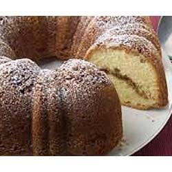 Moist Sour Cream Coffee Cake Recipe - Sour cream enriches this batter yielding a tender, moist cake laced and topped with a sweet pecan, brown sugar and cinnamon streusel.