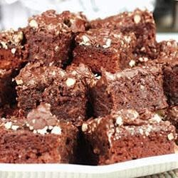 Baked Fudge Recipe - A sweet gooey mixture of sugar, flour, cocoa, eggs, butter, vanilla and pecans becomes an irresistible panful of baked rich sweetness.