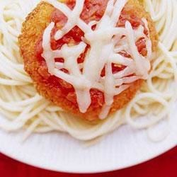 Easy Chicken Marinara Recipe - Use Classico(R) Four Cheese pasta sauce to top the chicken patties. Mozzarella cheese melts on top of this quick spaghetti dinner.