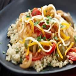 Mediterranean Chicken and Couscous Recipe - Browned chicken breasts with onions, tomatoes and olives in a balsamic sauce are served over fluffy couscous.