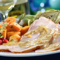 Ham with Maille(R) Orange Sauce Recipe - Here's a delicious orange sauce with mustard that's perfect served with sliced ham, pork chops, or pork tenderloin, or as a glaze spooned over your favorite baked ham.