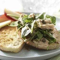 Tuscan Tuna Sandwich Recipe - Capers, dill, and balsamic vinaigrette with baby salad greens make an everyday tuna sandwich a special lunch-time treat.