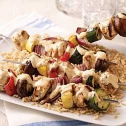 Tomato-Basil Chicken Kabobs Recipe - Marinated in a creamy tomato-basil sauce, chunks of chicken are grilled with green and yellow zucchini, red pepper, red onions, and mushrooms for a quick and colorful meal.