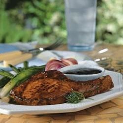 Glazed Pork Chops Recipe - Ketchup, steak sauce, garlic, mustard and SMUCKER'S(R) Blackberry Jam magically blend into a sweet tangy glaze for broiled pork chops.