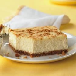 PHILLY Lemon Cheesecake Recipe - A light layer of of graham cracker crumbs adds a bit of crunch to the top of this luscious lemon cheesecake.